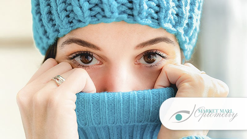 Woman protecting eyes in the winter time - Calgary eye clinic